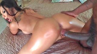 Desirable Asian hottie rides on a large black piston