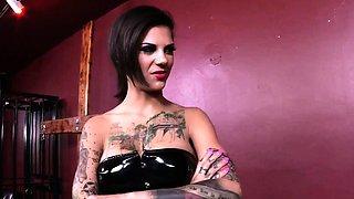 Tattooed latex dominatrix fucks new mistress