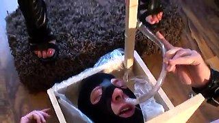 Sexy slender brunette dominatrix punishes her masked slave