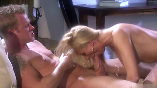 Diana Doll gives her stud the come hither kiss as she pulls him