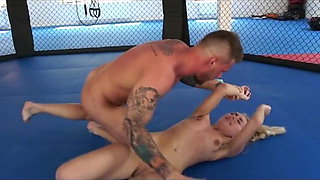 blonde has cock shoved in her mouth in wrestling match