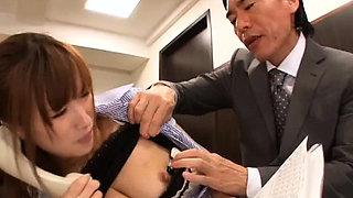 Breasty businesswoman recieves a hard knob from her boss