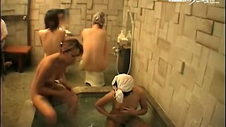 Threesome of Asian dolls helping each other wash in shower 03224