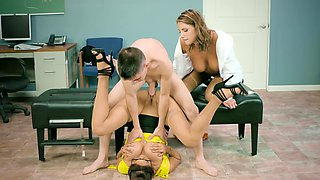 Two women are in the threesome in the nurses office