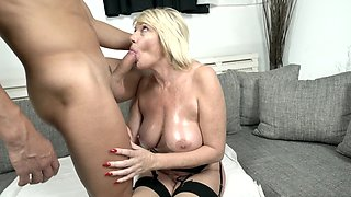 Old blonde in stockings enjoys sex with slick-haired crusher