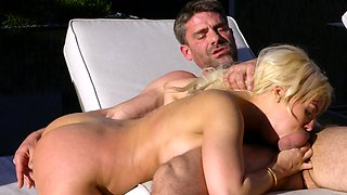 Man and his enchanting woman have fun on sun lounger