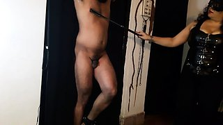 Helpless amateur guy gets spanked by a masked dominatrix