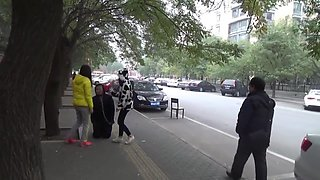 The slave was ridden outdoor and kneel down on the road while slapped