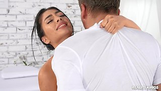 Romantic lovemaking on the massage table with oiled Tru Kait
