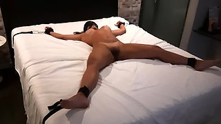 Busty amateur brunette gets tied up and gagged on the bed