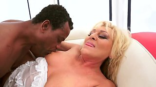 Mature blonde receives cunnilingus and blows black man's cock