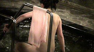 Horny voyeur shoots a pigtailed Oriental cutie in the bath