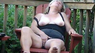 Granny masturbates on her porch