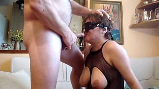 Mature slave girl on her knees deepthroating cock