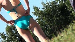 Voyeur follows attractive bikini babes enjoying the hot sun