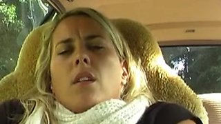 Blonde masturbating in the car in the parking lot