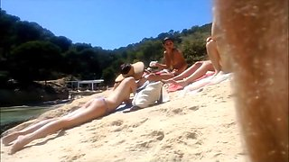 four topless college girl at the beach