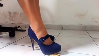 Dominant lady in high heels has her slave licking her toes