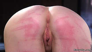 Redhead slave in straitjacket tormented