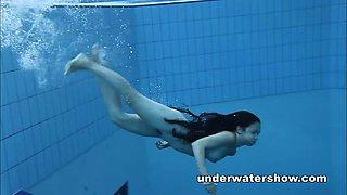 Cute Umora is swimming nude in the pool