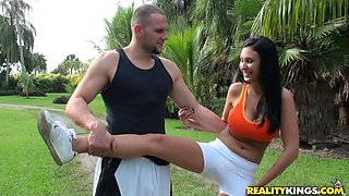 Nice brunette with oiled up boobs gets fucked outdoors