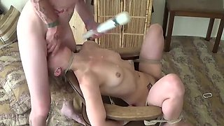 Teen slut used and abused while bound to a chair.