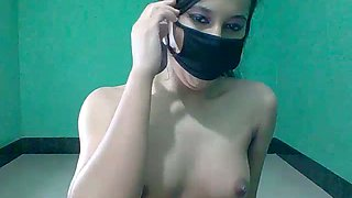 Masked cutie works on webcam and exposes her amateur Indian tits