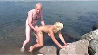 Old man fucks on the beach