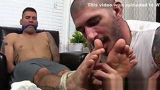 Sucking toes and worshiping them with a muscular hunk man