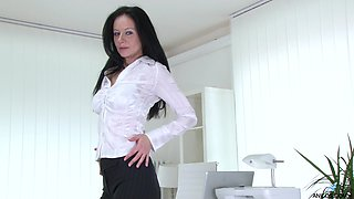 Skinny mature Enza spreads her legs to play with her pussy in the office