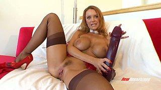 Redheaded milf pumps a huge dildo deep into her vagina