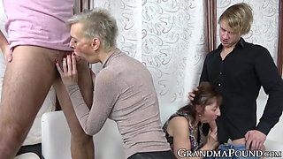 Old and young foursome with two cute horny grannies pounding