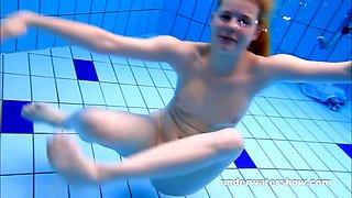Cute Lucie is stripping underwater