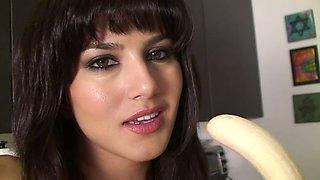 Gorgeous busty brunette Sunny Leone enjoys sucking banana on cam