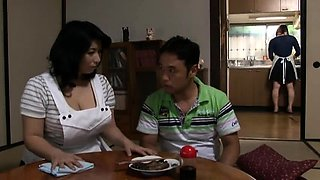 Big breasted Japanese mom has a young stud plowing her pussy