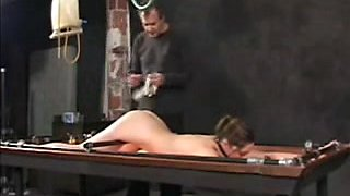 Tied and gagged brunette babe gets an enema