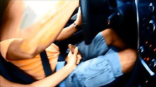 Sexy babe displays her handjob and blowjob skills in the car