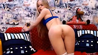 Slender blonde camgirl in stockings flaunts her perfect ass