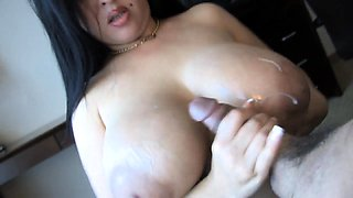 Big breasted cougar plays with her pussy and worships a cock