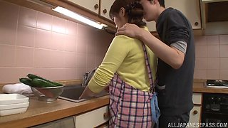 Naturally busty Asian housewife likes having her natural tits sucked